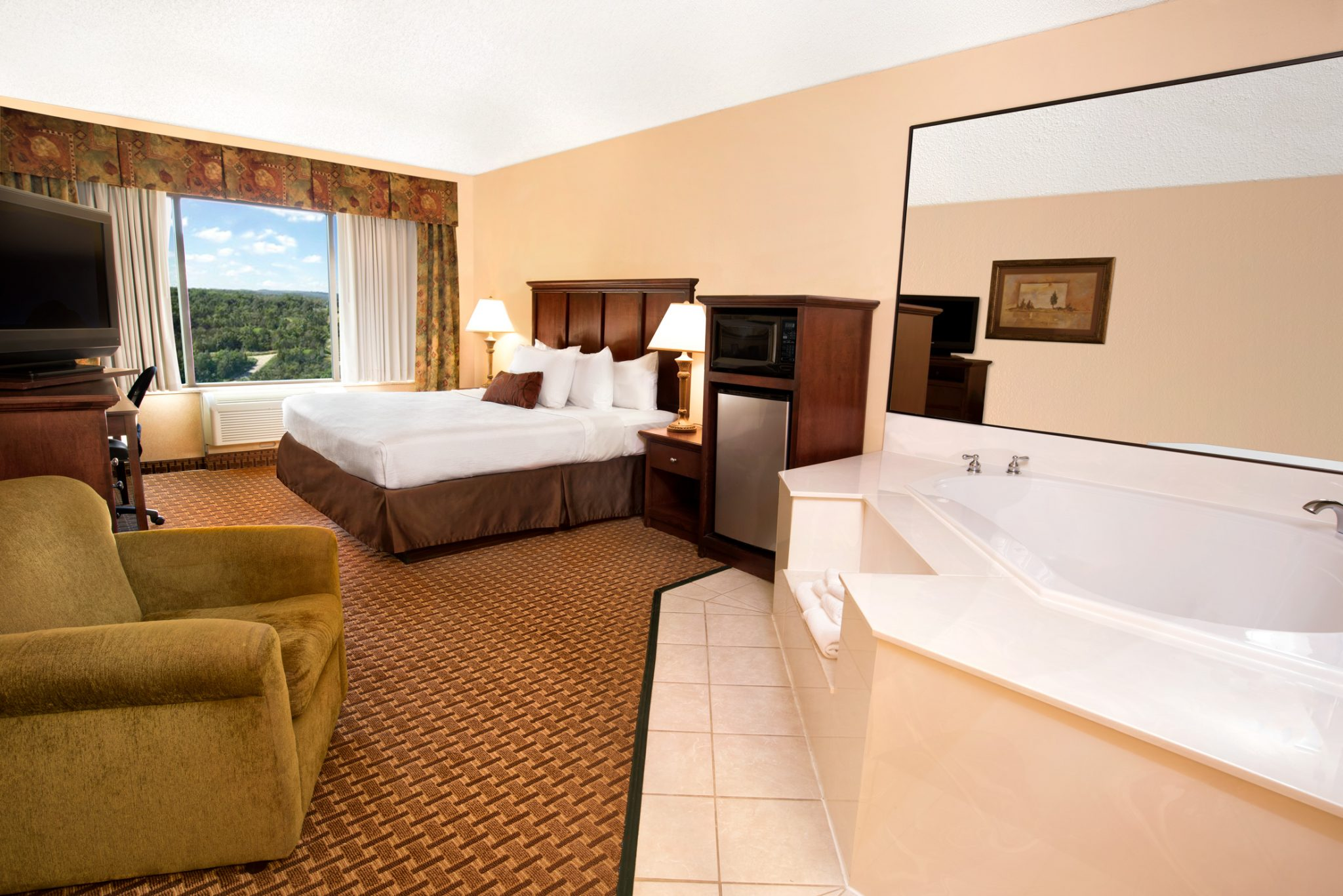 Honeymoon Suite A Deluxe Two Room Perfect For Couples Or Traveling Executives Visiting Branson Missouri The Bedroom Is Furnished With King Size